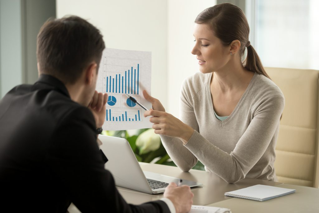 Female entrepreneur showing graph on ways to increase revenue