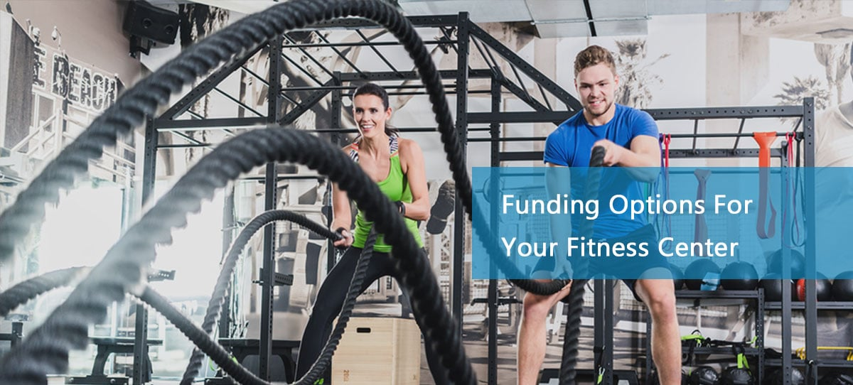 Man and woman training thanks to a fitness center business loan