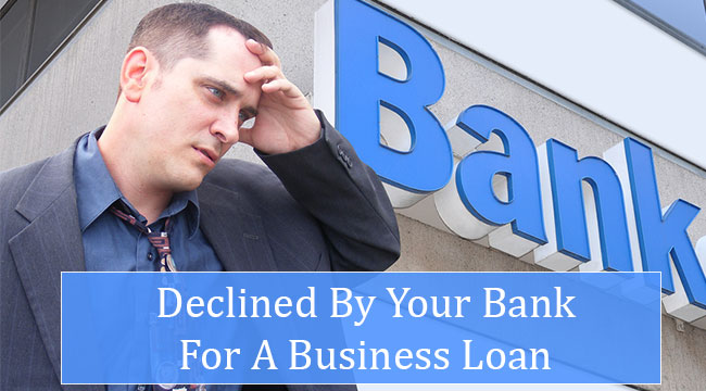 Frustrated businessman leaving bank after being declined for business loan