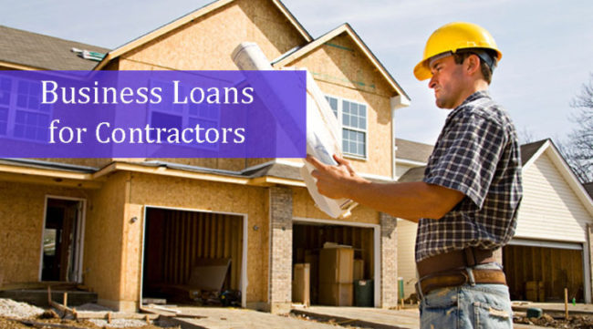 Foreman reviewing house plans thanks to a business loan for contractors